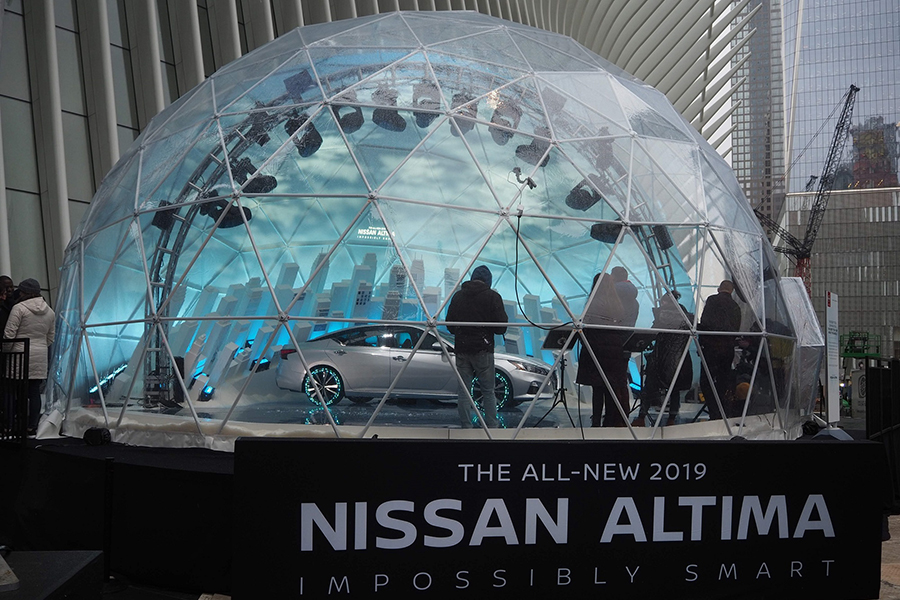 nissan almia in arch truss with artist picasso lights